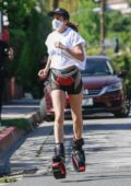 Elisabetta Canalis flaunts her toned legs as she goes for a run wearing tiny shorts and Kangoo Jumps in Beverly Hills, California