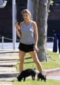 Elisabetta Canalis wears a grey tank top and shorts as she takes her dogs for a walk in Los Angeles