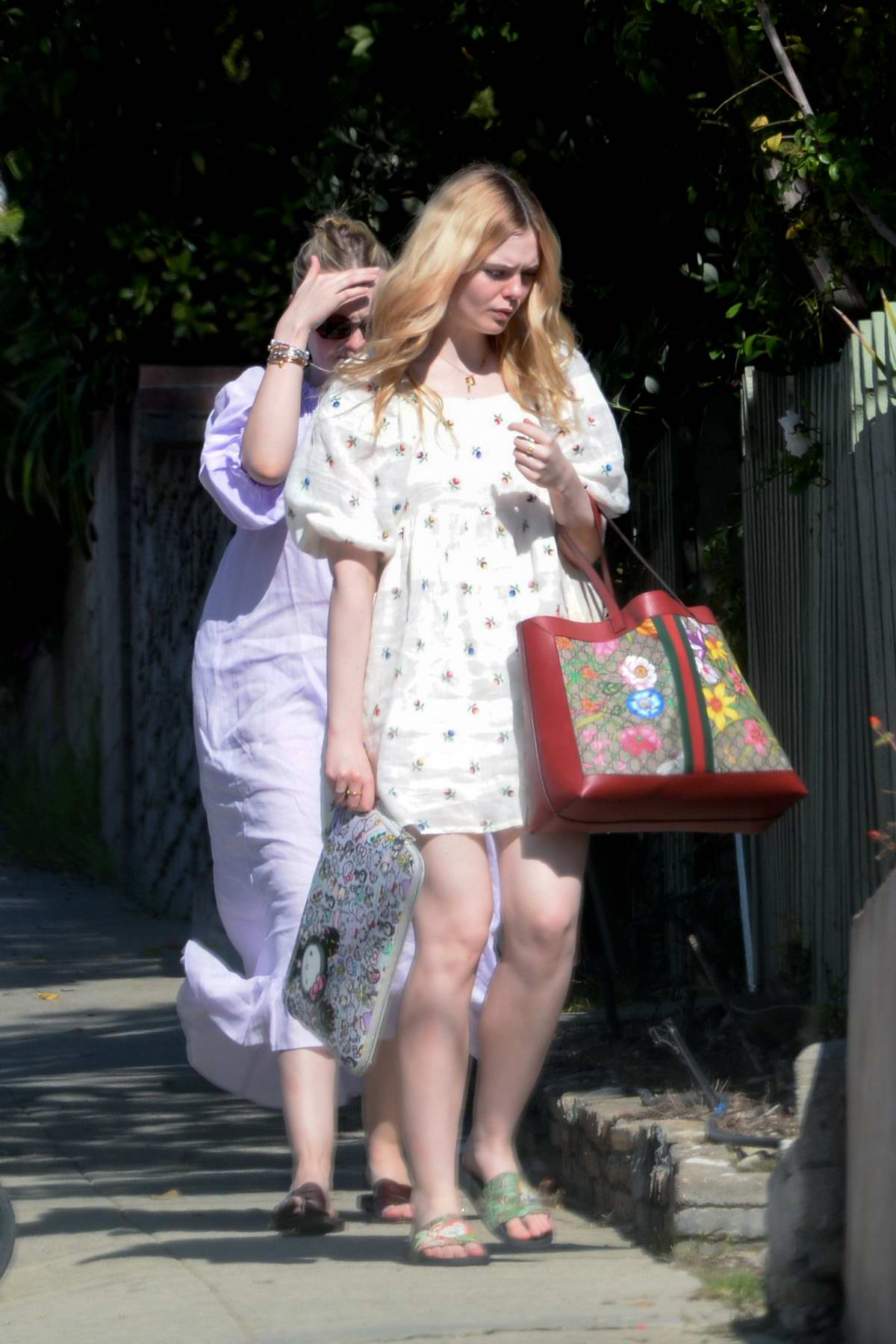Elle Fanning and Dakota Fanning step out together in Los Angeles