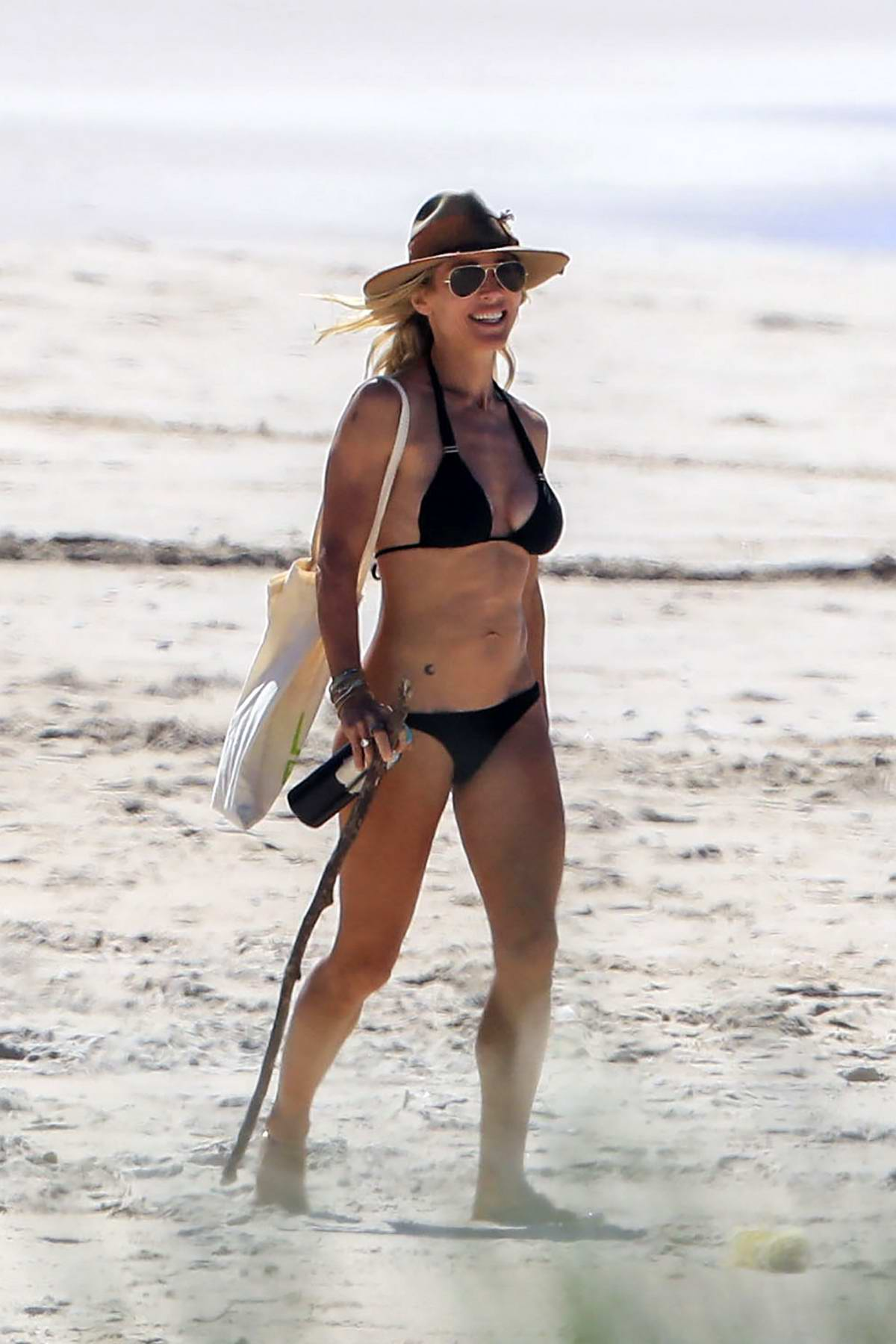 Elsa Pataky seen wearing a black bikini on empty beach in Byron Bay, Australia