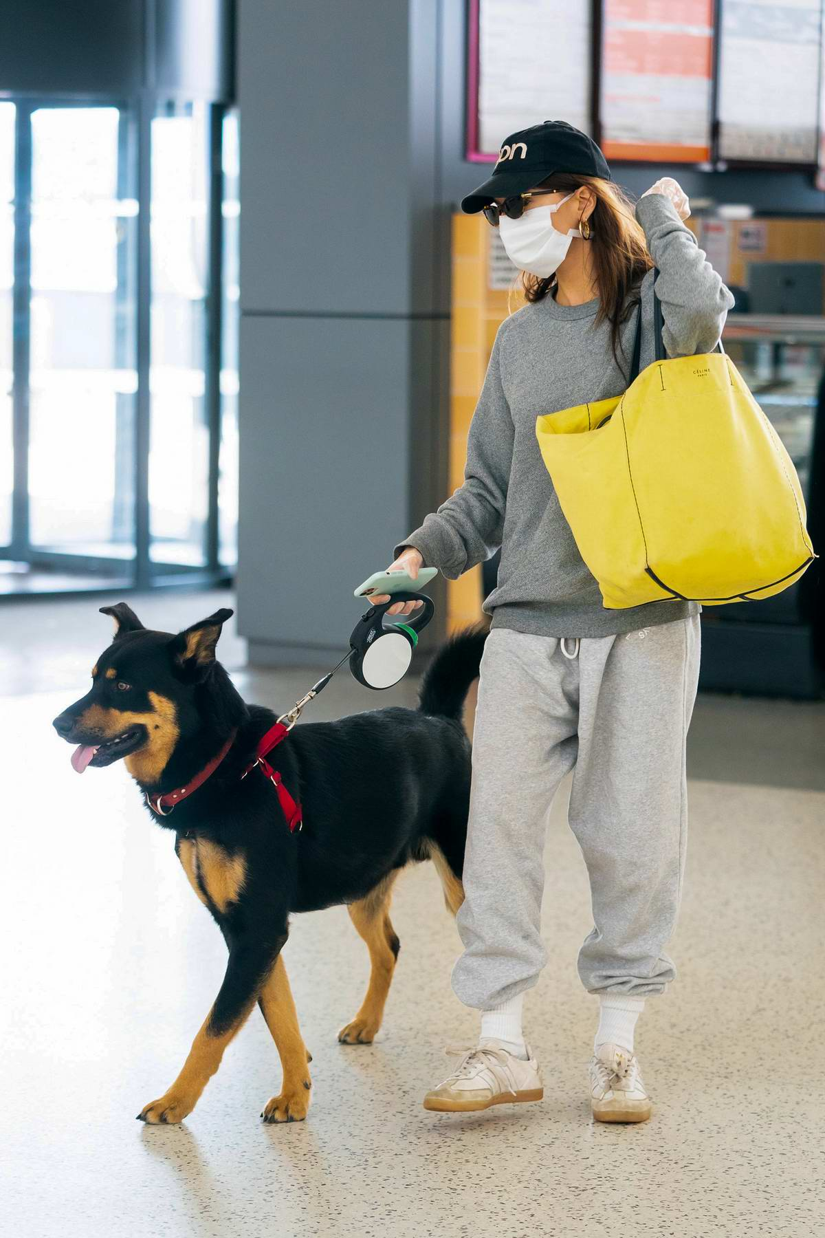 Emily Ratajkowski and Sebastian Bear-McClard arrive with their dog for a flight out of JFK Airport in New York City