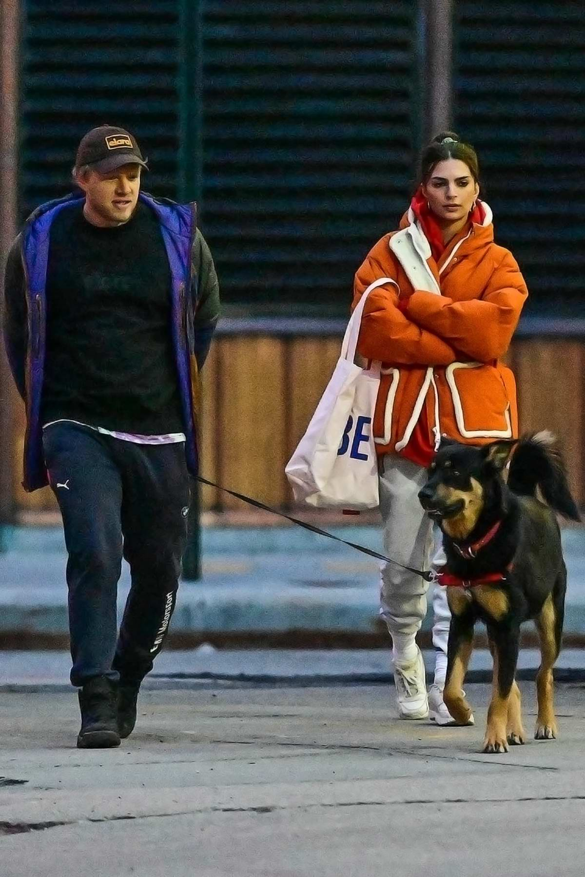Emily Ratajkowski and Sebastian Bear-McClard step out to walk their dog on empty streets of New York City