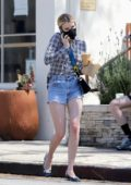 Emma Roberts shows off her slender legs in denim shorts while out for an iced coffee in Los Angeles