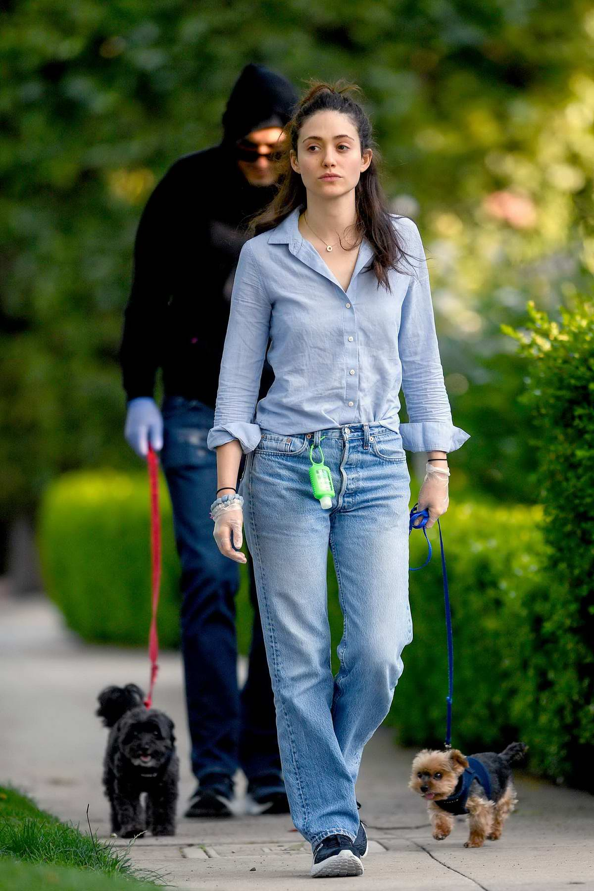 Emmy Rossum looks great in a blue shirt and jeans while out for walk with Sam Esmail in Los Angeles