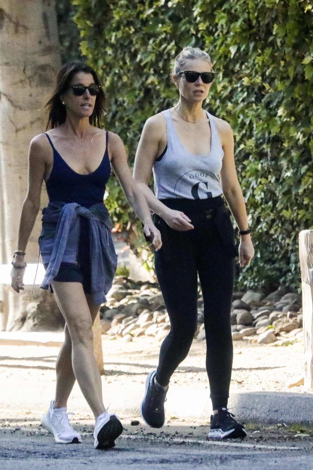 Gwyneth Paltrow wears 'Goop' tank top while out on early morning walk with a friend in Los Angeles