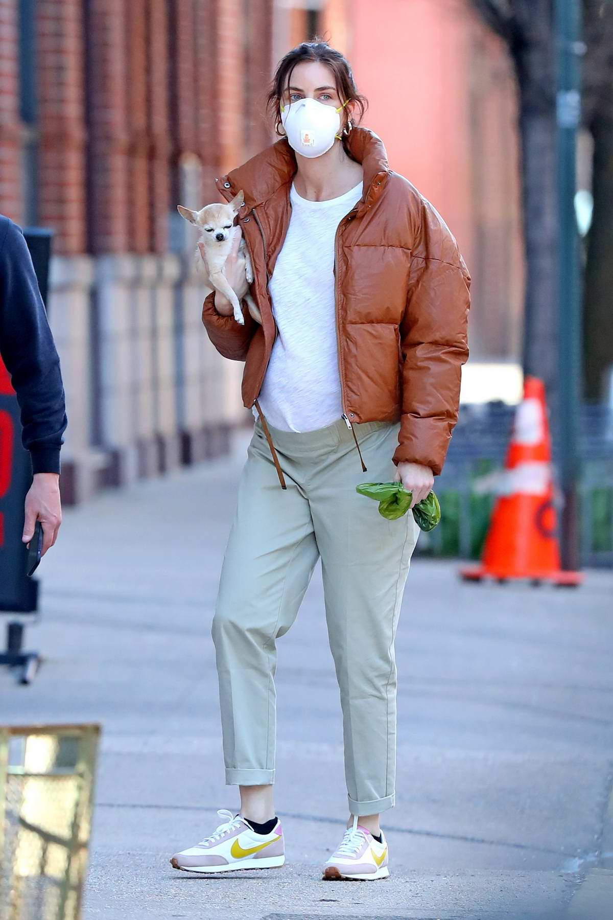 Hilary Rhoda shows her baby bump while out for a walk with husband Sean Avery in New York City