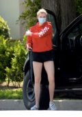 Ireland Baldwin rocks a red hoodie and black shorts while picking up some beverages in Los Angeles