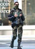 Irina Shayk looks stylish in Moschino camouflage jumpsuit and Burberry puffer jacket as she steps out in New York City