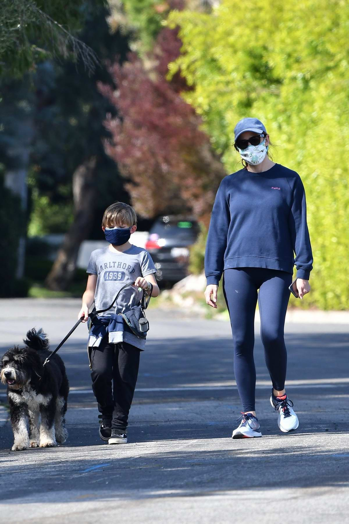Jennifer Garner takes the dog for a walk with her son in Brentwood, California