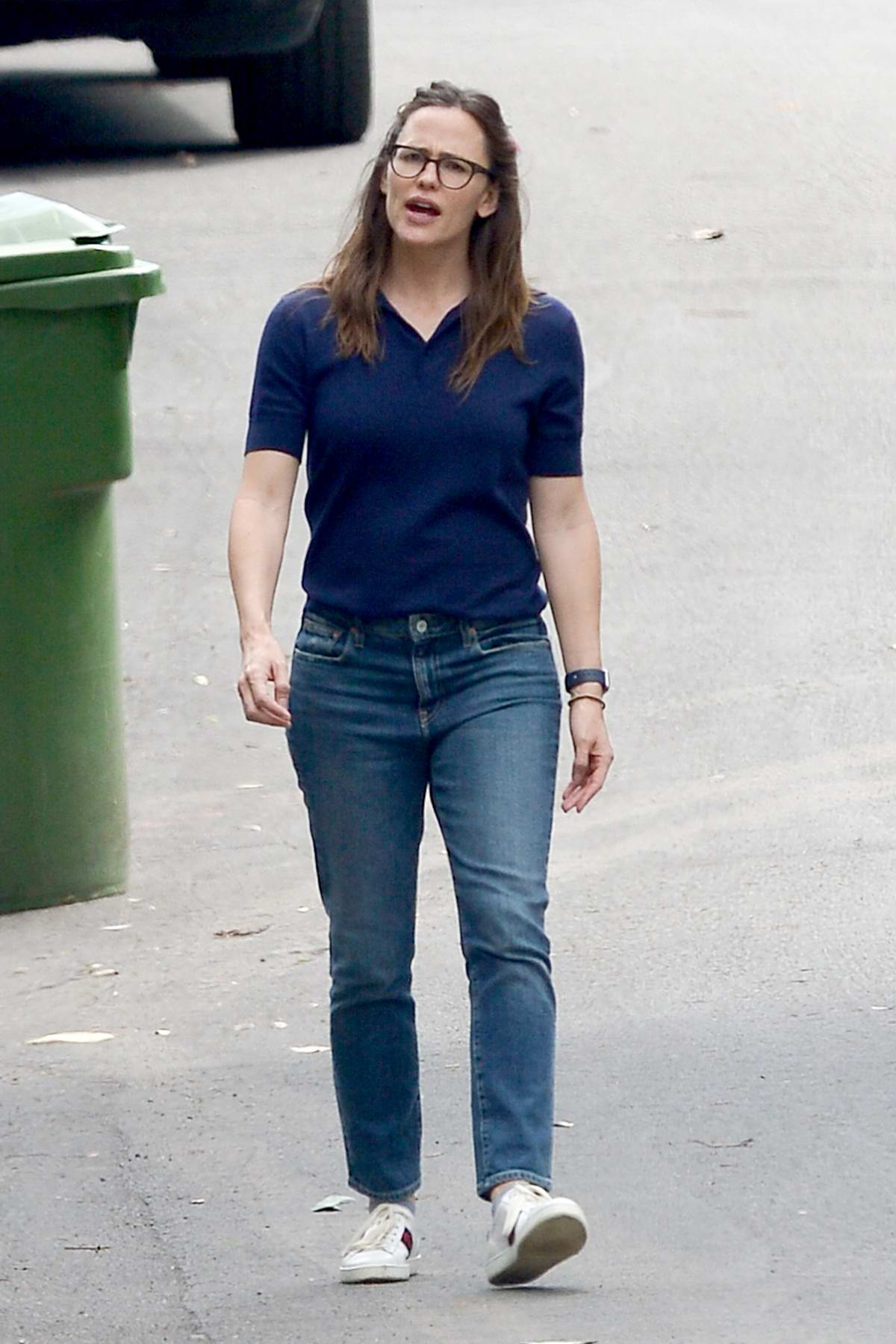 Jennifer Garner wears a dark blue polo shirt and jeans while out for walk in Los Angeles