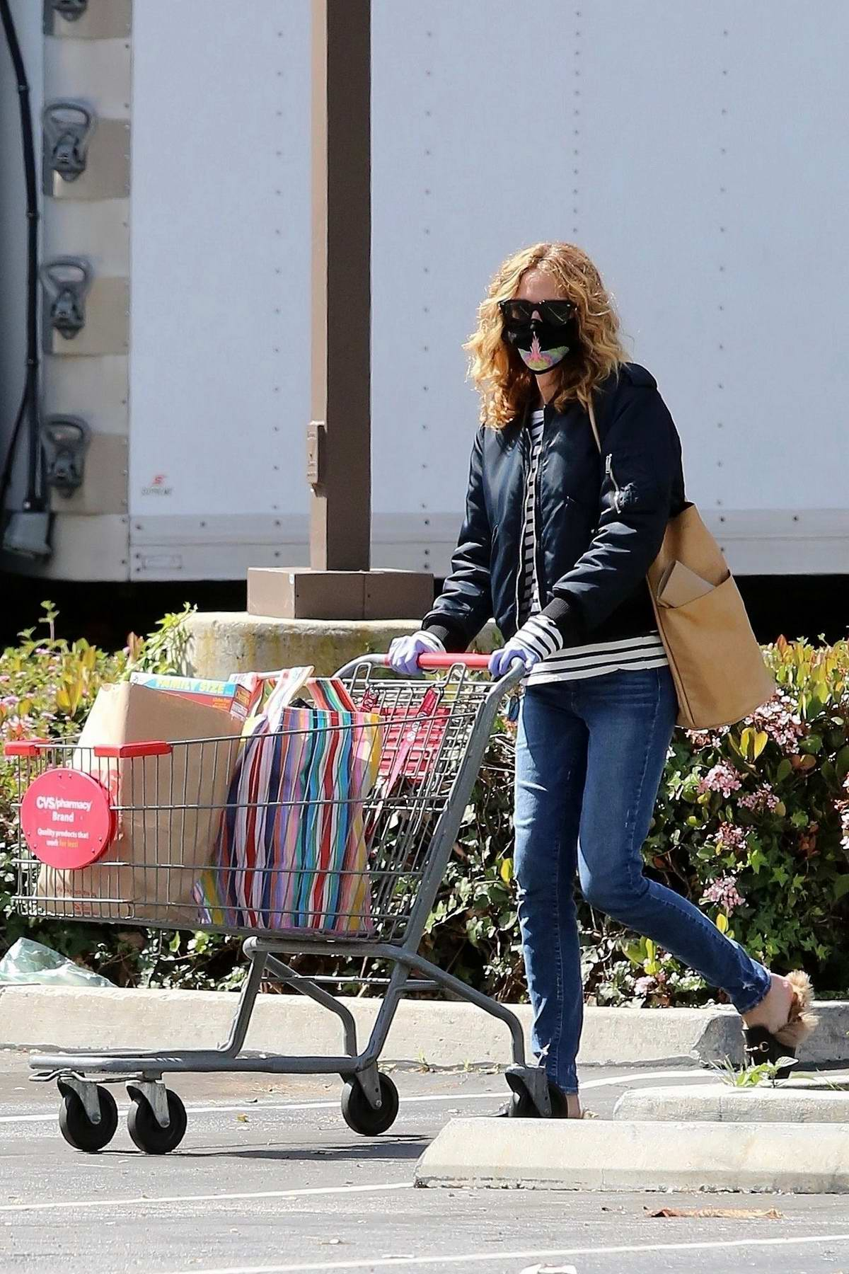 Julia Roberts dons a face mask and gloves as she stops to pickup some essentials at CVS Pharmacy in Los Angeles