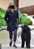 Julie Benz dons a protective mask as she takes her dog for a walk in Beverly Hills, California
