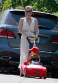 Kate Mara takes her daughter for a stroll on her toy car in Los Feliz, California