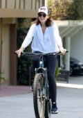 Katherine Schwarzenegger is all smiles while out for a bike ride in Santa Monica, California