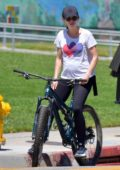 Katherine Schwarzenegger shows her baby bump while enjoying a bike ride with Chris Pratt in Santa Monica, California