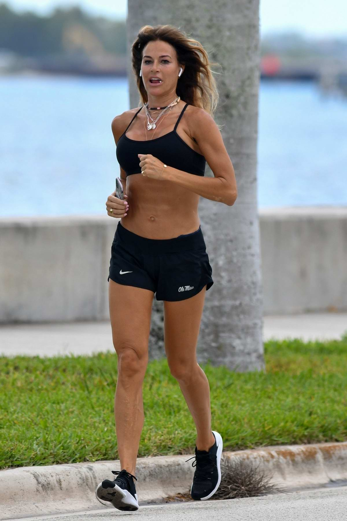 Kelly Bensimon shows off her fit body in a crop top and shorts while out for a run in Palm Beach, Florida