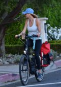 Kelly Rohrbach takes a break from quarantine as she goes for a bike ride in Brentwood, California