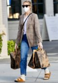 Kelly Rutherford seen wearing mask and gloves as she picks up groceries at Erewhon Market in Los Angeles