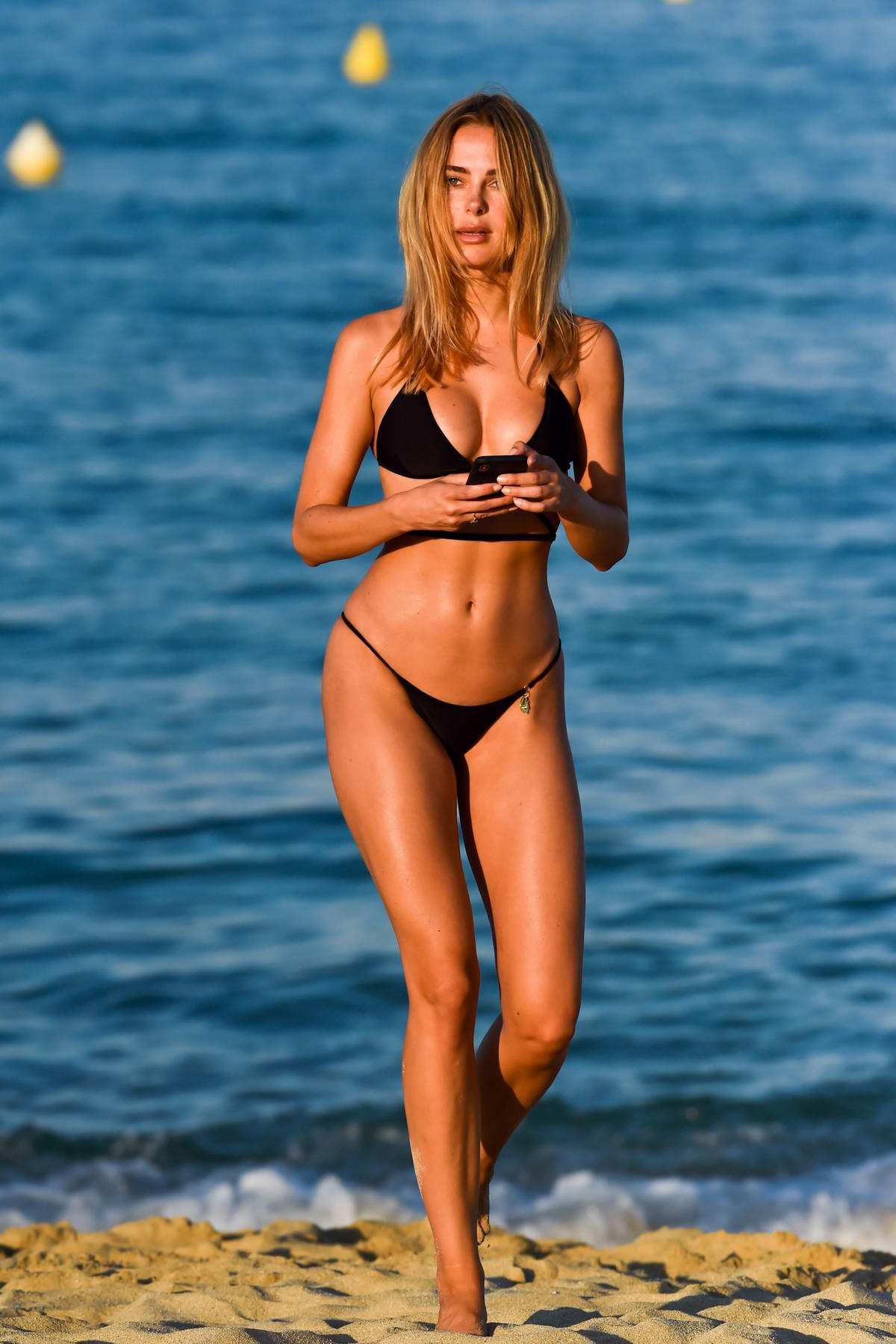 Kimberley Garner stuns in a black bikini as she hits the beach while on holiday in Miami, Florida