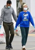 Kristen Wiig and fiance Avi Rothman wear face masks and rubber gloves during shopping trip to CVS in Los Angeles