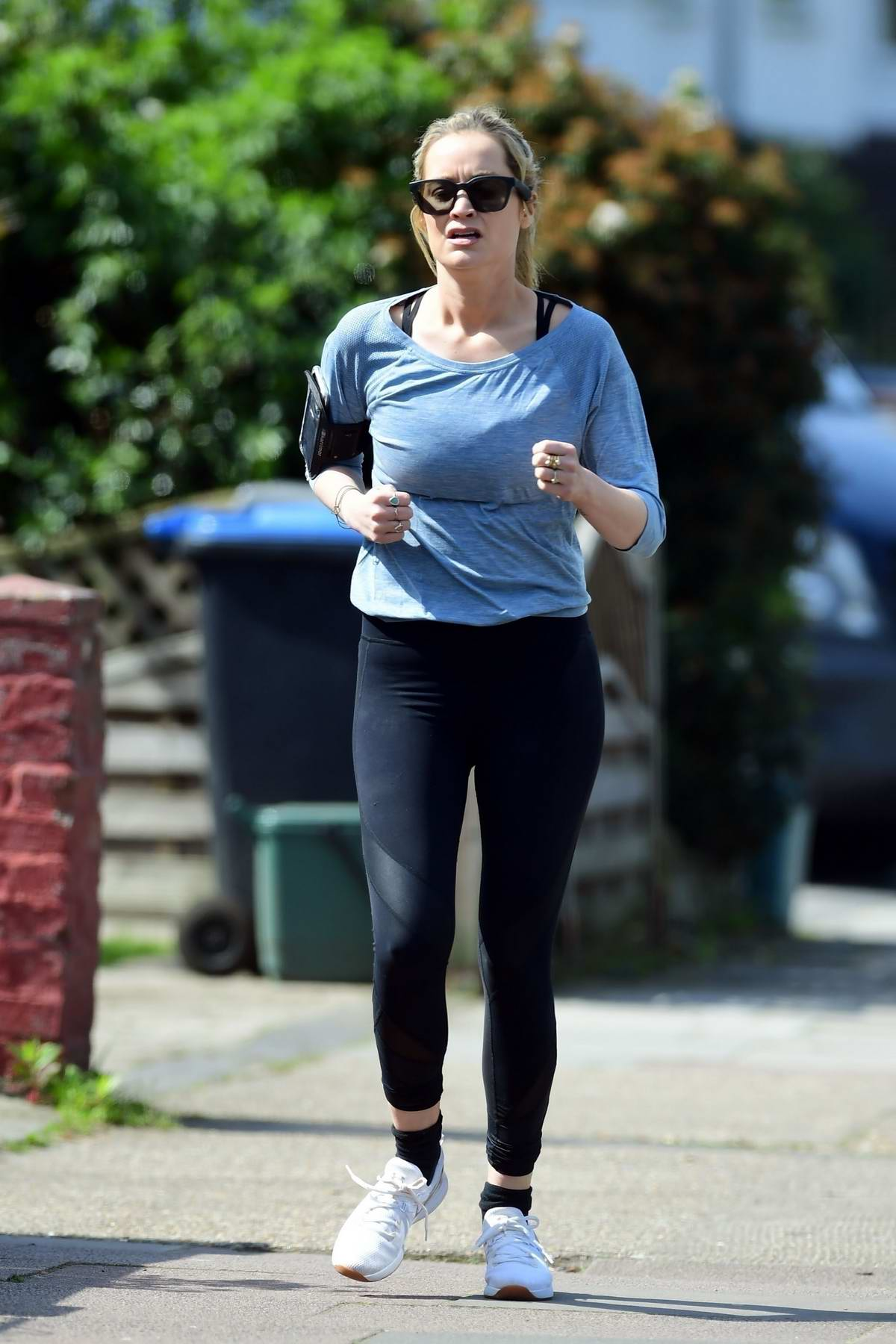 Laura Whitmore keeps up with her fitness routine as she goes for a run in London, UK
