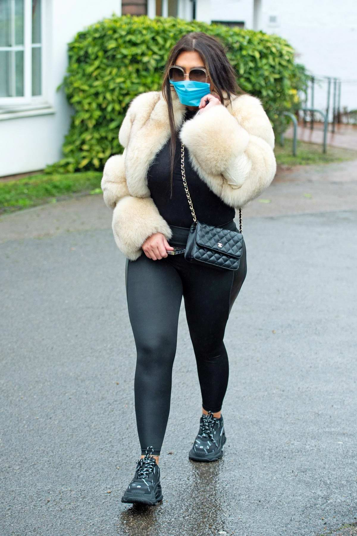 Lauren Goodger seen wearing leggings and a fur coat along with a blue mask as she leaves her home in Essex, UK