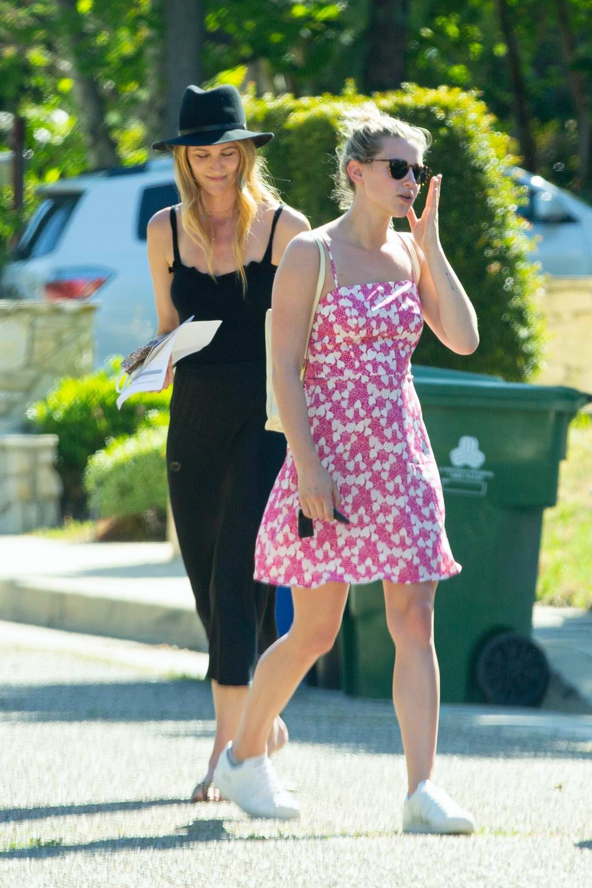 Lili Reinhart is pretty in pink as she goes house hunting with a real estate agent in Los Angeles