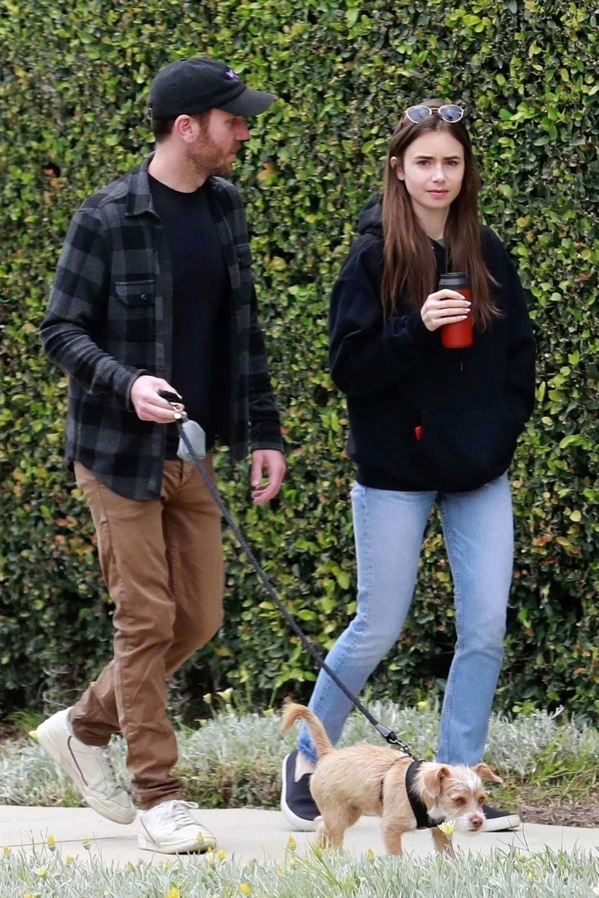 Lily Collins and boyfriend Charlie McDowell share a few laughs while out for walk with their dog in Beverly Hill, California