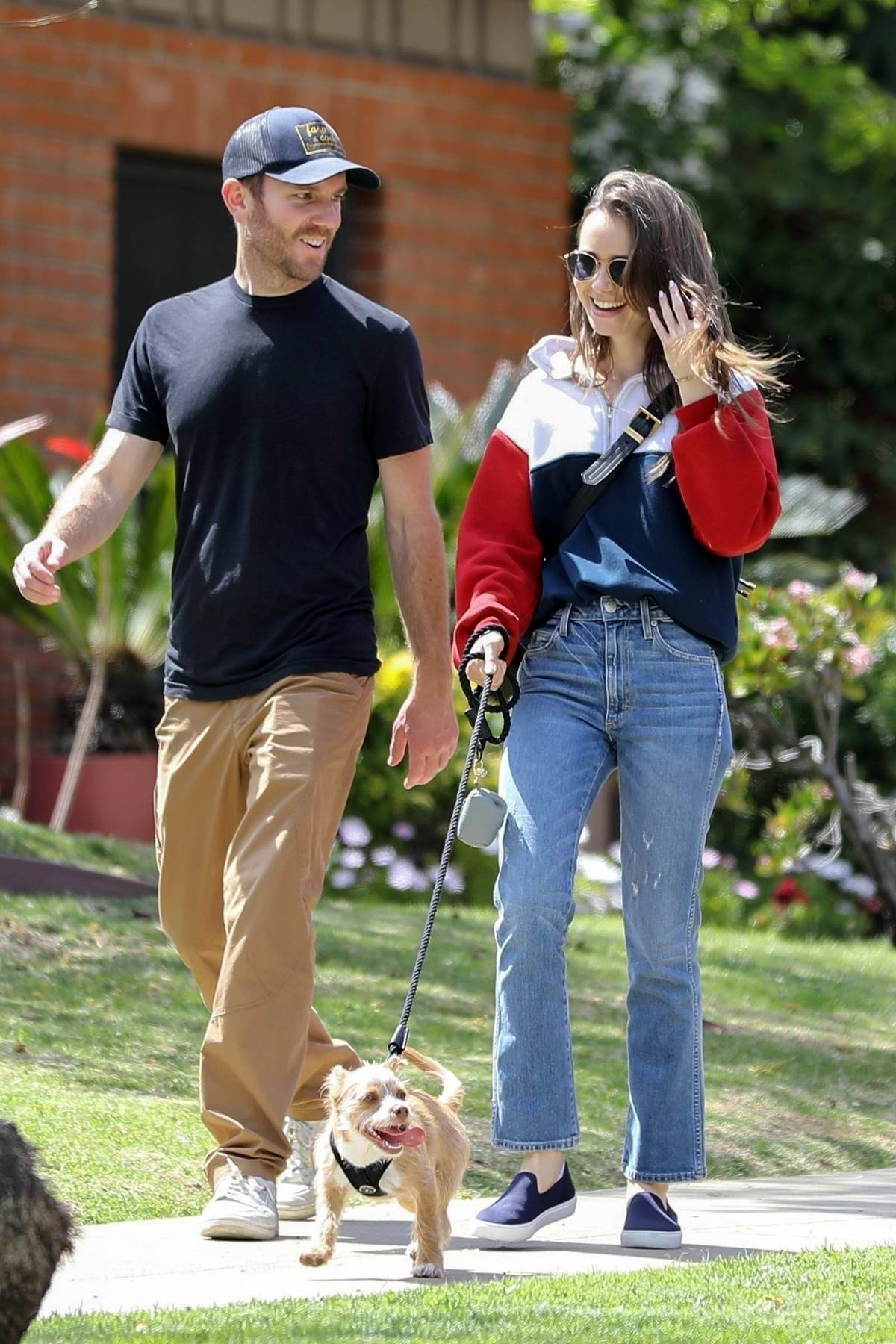 Lily Collins and Charlie McDowell share a few laughs while walking their dog in Beverly Hills, California
