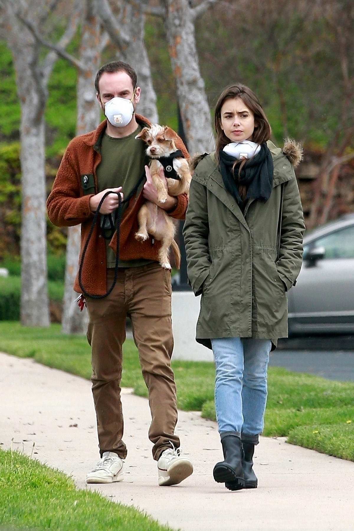 Lily Collins and Charlie McDowell step out for their daily stroll in Los Angeles
