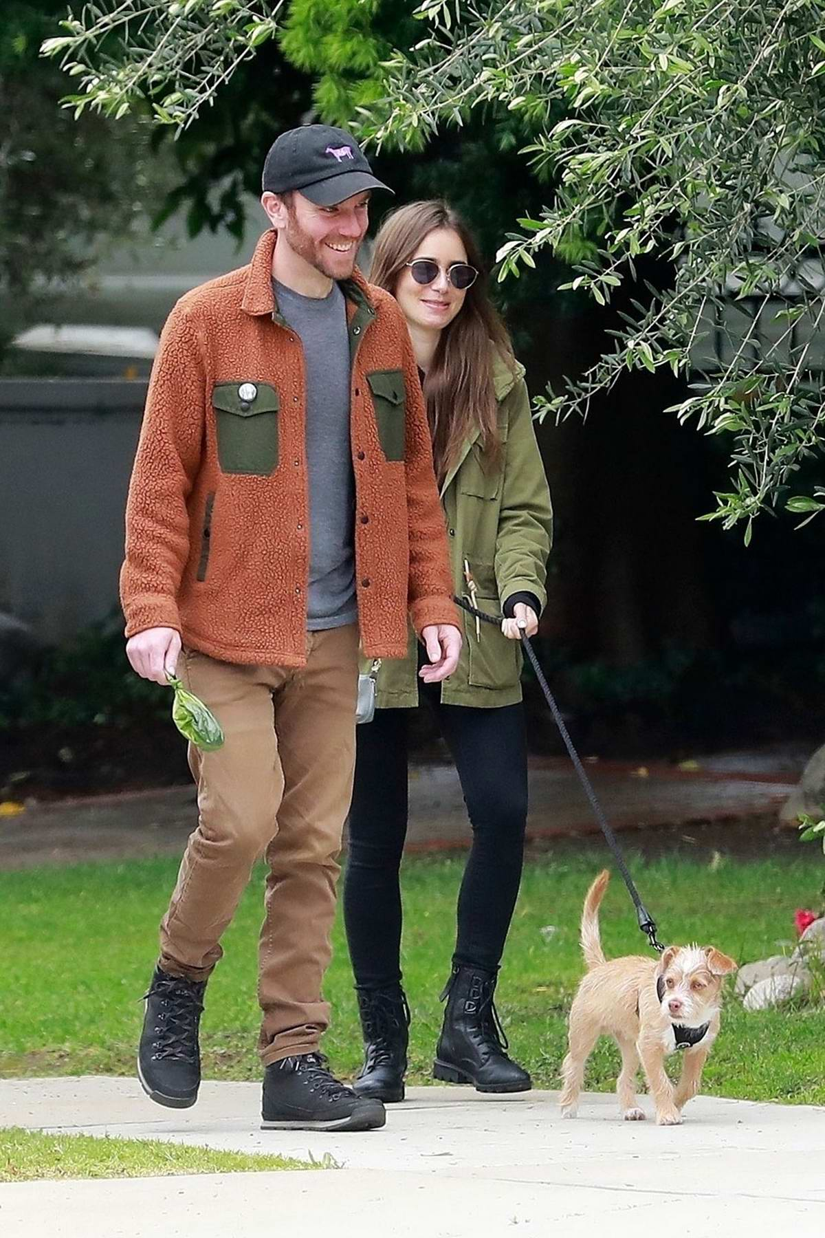 Lily Collins and Charlie McDowell take their daily walk with their dog in Beverly Hills, California