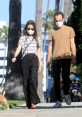 Lily Collins and Charlie McDowell take their dog out for a walk in Beverly Hills, California