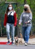 Lily Collins steps out for a walk with her mother in Beverly Hills, California