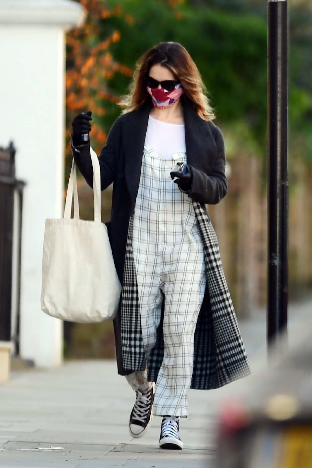Lily James seen wearing a colorful mask and checkered overalls as she steps out in North London, UK