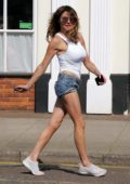 Lizzie Cundy steps out in a white tank top and denim shorts in London, UK