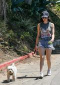 Lucy Hale displays her legs wearing denim shorts while out with her pup in Beverly Hills, California