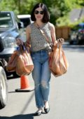 Lucy Hale puts on a mask and disposable latex gloves during a grocery run in Los Angeles