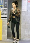 Lucy Hale sips on her drink as she leaves after a private training session in Los Angeles