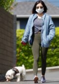 Lucy Hale sports a blue jacket and green leggings as she steps out to walk her pup Elvis in Los Angeles