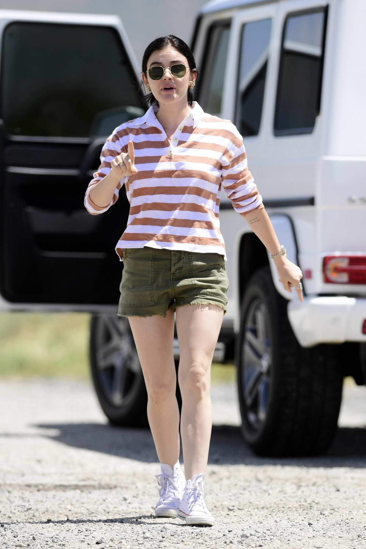 Lucy Hale sports a striped polo shirt and denim shorts while out in Los Angeles