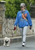 Lucy Hale steps out with her pup for an evening stroll in Los Angeles