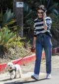 Lucy Hale wears a striped shirt and jeans as she steps out to walk her pup in Los Angeles