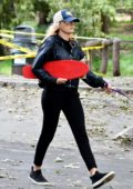 Malin Akerman carries her shortboard as she steps out for a hike with her dog in Los Feliz, California