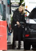 Malin Akerman makes a stop at a gas station to fill up her car in Los Angeles