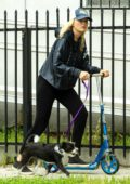 Malin Akerman rides a scooter while out to walk her dog in Los Angeles