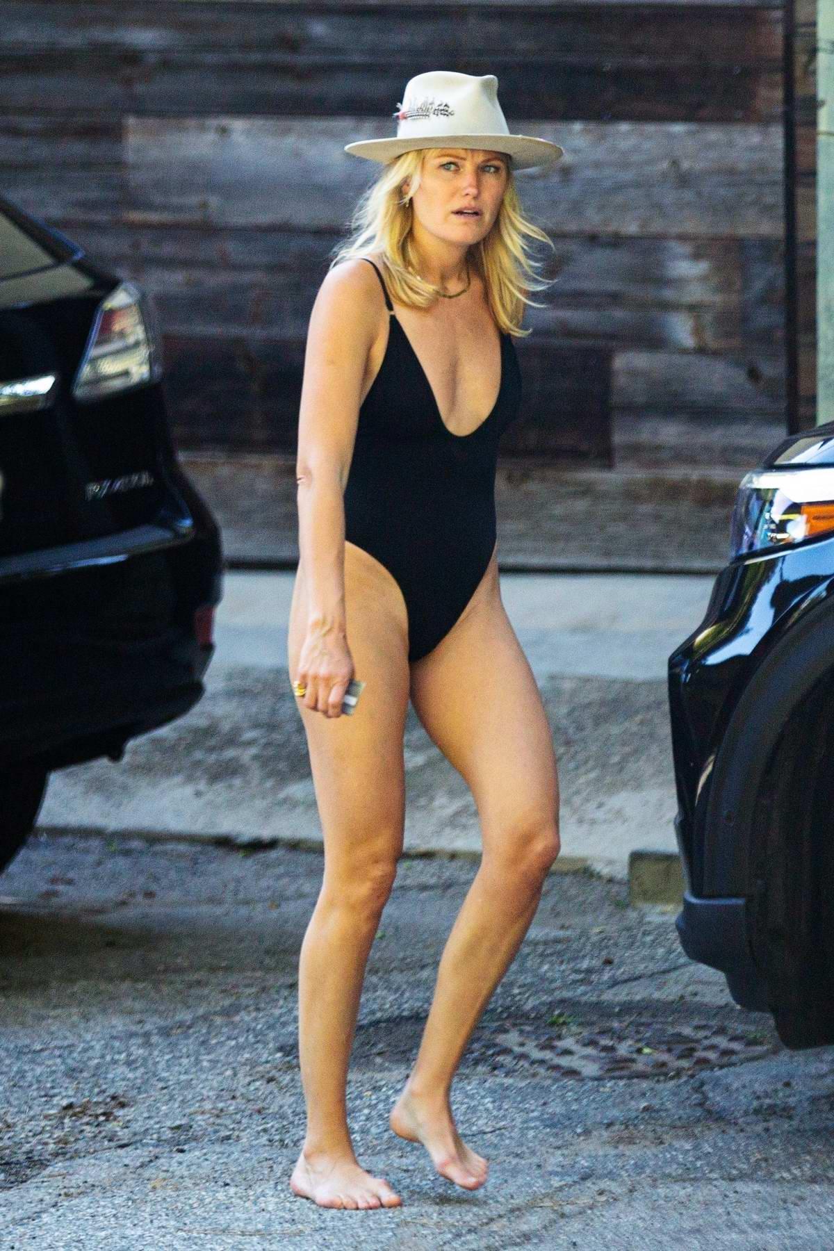 Malin Akerman seen wearing a black swimsuit as she steps outside her home in Los Angeles