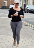 Malin Andersson wears a black top and grey leggings as she goes for a run in London, UK