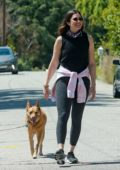 Mandy Moore greets her neighbor from a distance while walking her dog with Taylor Goldsmith in Los Angeles