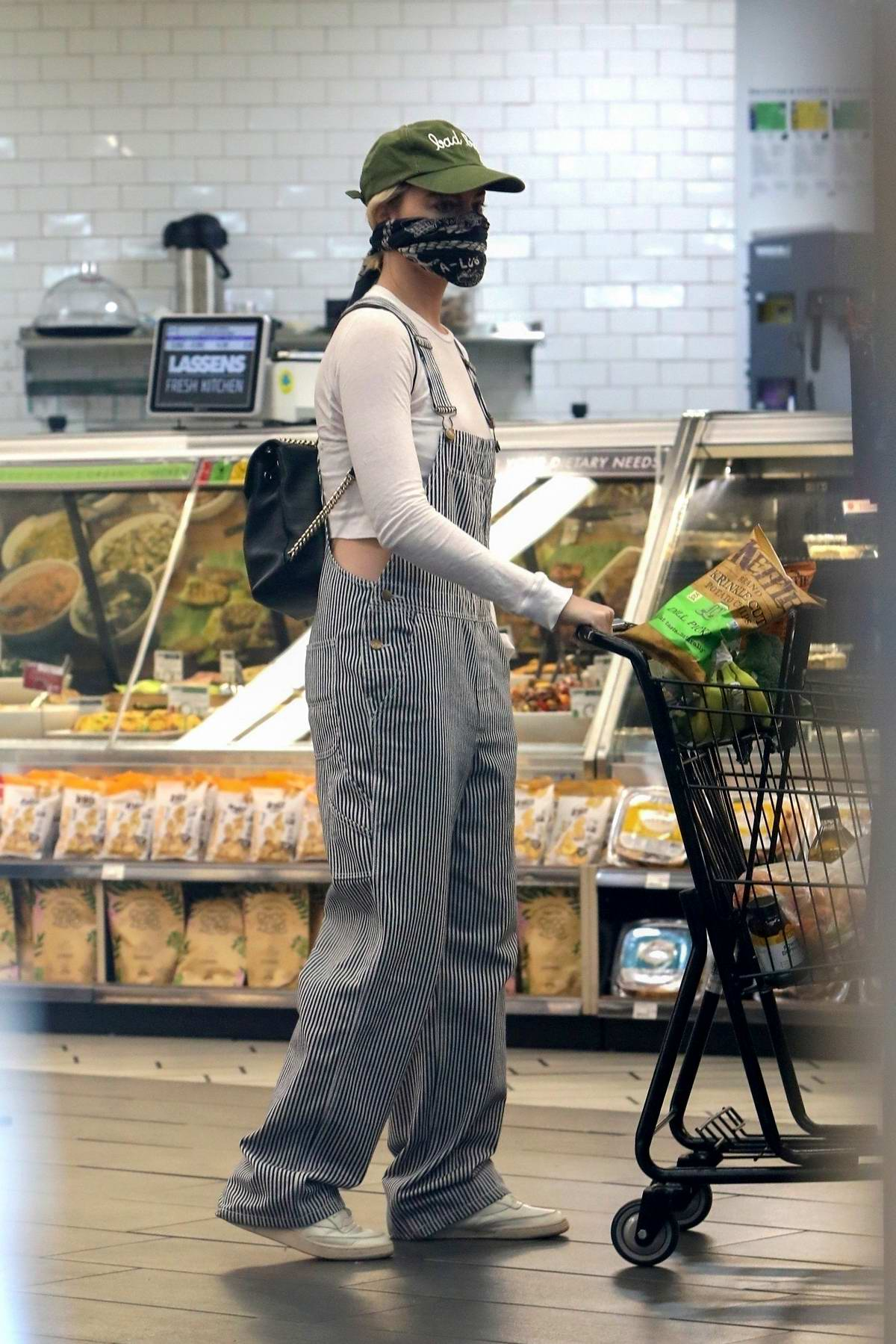 Margot Robbie seen wearing striped grey overalls and a bandana mask during a grocery run in Los Angeles