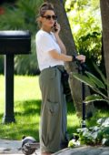Maria Menounos wears a crop top and baggy pants while out for a scooter ride in Los Angeles